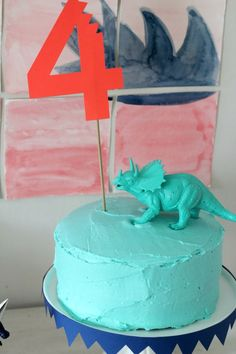 four dinosaur cake topper