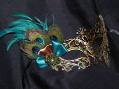 New to TheCraftyChemist07 on Etsy: Peacock Metal Masquerade Mask with Teal and Bronze Accents (55.00 USD)