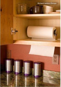 Under cabinet mounted paper towel holder