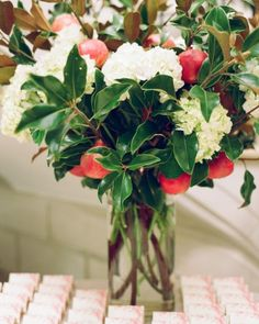 I like the fruit in the flower arrangement.