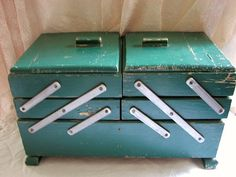 Vintage Sewing Box.  I have a bit more modern version (circa 1950's) that is walnut stained