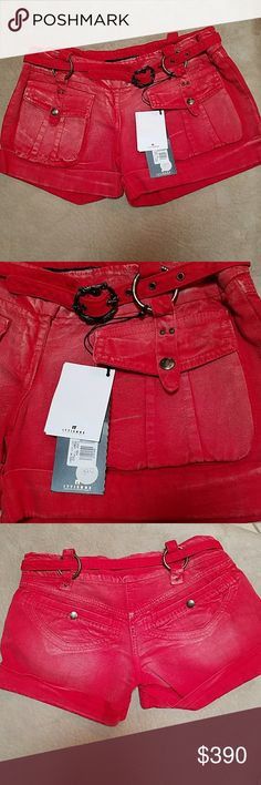 "Just Cavalli red cropped shorts NWT Just Cavalli red distressed cropped shorts   NWT $390  Size 26. Measured waist flat at 14"" Length 10"" to 11"" rise 7""  Deep front pockets w snap buttons,  shallow back pockets dome at angle w snap button Beautiful belt w metal loops    offers always considered Just Cavalli Shorts Jean Shorts"