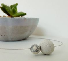 Contemporary and minimal concrete beads.