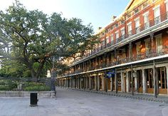 The Pontalba Apartments -- oldest continually inhabited apartments in the U.S.    They flank either side of Jackson Square in the French Quarter of New Orleans