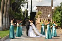Bride and groom releasing the balloons. Turquoise/ Teal wedding
