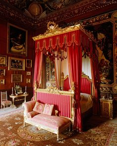 An 18th century four-poster bed in this George bedroom is decked out for Queen Victoria's visit in 1840.