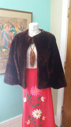 Check out this item in my Etsy shop https://www.etsy.com/listing/223947847/vintage-brown-faux-fur-stylecape-by-ir