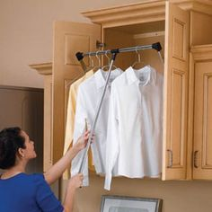 use any empty space above regular reaching height with a pull-down closet rod for all of your out-of-season or less-used stuff. | On Amazon for $68+