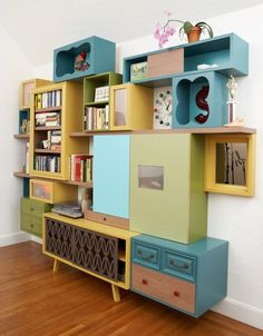 I LOVE this - mix of old retro pieces and some old drawers and you have a stylish wall feature