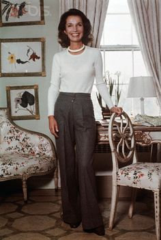 Love this classic look - grey slacks, white light sweater, & of course, pearls......................in this photo: {Lee Radziwill - (Jackie Kennedy's sister)}