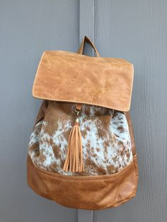 Backpack with tassel golden by Canoe 67c3587b2d25f
