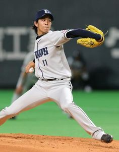 Takayuki Kishi goes 6-plus innings of 3-run ball with striking out 2 as he picks up his 9th win of the season at Sapporo Dome on August 27, 2013 in Sapporo, Hokkaido.