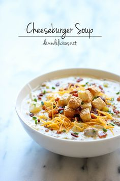 Cheeseburger Soup - All the flavors of a cheeseburger in a creamy, comforting soup, topped with crisp bacon and hamburger bun croutons!