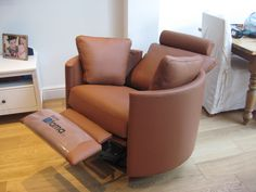 Mid-brown leather was commissioned for this electric swivel chair. Ideal for a contemporary open plan living room.