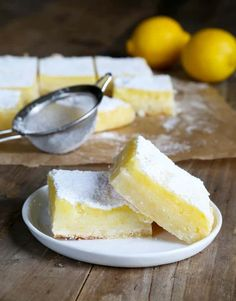 A simple lemony shortbread crust with a tart, refreshing lemon custard, these gluten free lemon bars are so easy to make. Perfect for any potluck! https://glutenfreeonashoestring.com/gf-lemon-bars-for-dad-plain-lemons-for-me/