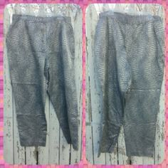 "??List Snake skin plus pants Faux snake skin, of course ?? Metallic silver and grey. Made in USA. Pre-loved, flawless condition! Waist is 36"" around, inseam is 28"". Size says 20, but the waist measurement puts it at a 16-18.   57% cotton 43% acetate  Dry clean only Ashley Stewart Pants Ankle & Cropped"