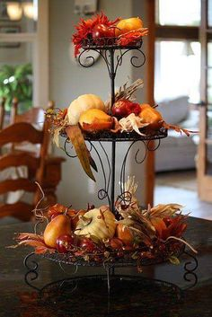 Fall/Thanksgiving decor- 3 tiered stand with pumpkins, gourds, etc. Think of other colorful fall items to place on 2 of the shelves so it won't be redundant. Table Halloween, Fete Halloween, Fall Home Decor, Holiday Decor, Autumn Decorating, Interior Decorating, Happy Fall Y'all, Fall Table, Decoration Table