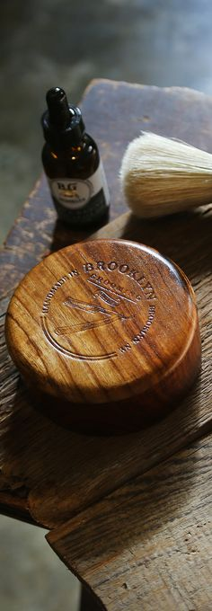 "A timeless, natural, handmade wooden shave soap bowl with lid. A must for any wet-shaver who uses shaving soap! Limited Edition Handcrafted from sheesham wood (Indian Rosewood) Brooklyn Grooming logo engraved on the lid Sealed for a long life Shaving bowl is approximately 3"" 3/4 in diameter and 1"" 5/8 height #natural #brooklyngrooming #shaving #mensgrooming"