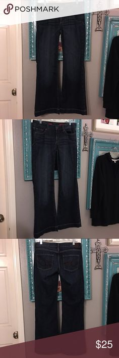 Express Eva Full Leg Size 4 Short Jeans Express Eva Full Leg Size 4 Short Jeans. Dark wash. 31 inch waist. 30 inch inseam. 98% cotton, 2% spandex. Like New Condition and no fraying or wearing on the backs. No rips, stains or holes. Smoke free home. Express Jeans Flare & Wide Leg