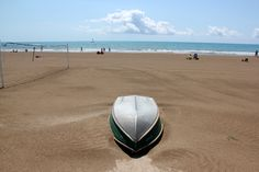 #Benicassim - a boat lying peacefully on the beach #travel #Spain