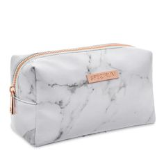 Finish your Instaworthy Marbleous Collection with the white marble print makeup bag. The soft faux leather bag is finished with a rose gold zip, stylish white l