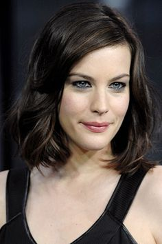 perfect hair color for her and for a Summer woman..... cool bittersweet chocolate brown.