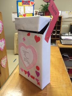 Valentine's mailbox made from a cereal box. John 3:16 verse with word Valentine going down.