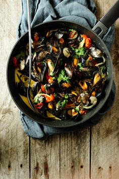Steamed mussels in coconut milk with garlic, coriander and chili pepper. A delicious meal, that is extremely easy to cook. It's a Thai-inflected version of