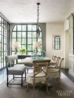 French bistro-style breakfast room in a Buckhead home by architect Peter Block. Interior designer Joel Kelly. Bungalow Classic chairs,  Restoration table.