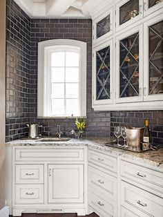 This is a traditional #kitchen with a modern backsplash. www.remodelworks.com ....GRAY subway tiles!