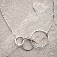 """Freshie and Zero """"Many Moons"""" Necklace- You'll dazzle in this Many Moons necklace by Freshie and Zero. As many moons pass, the style of this necklace is here to stay. Three hoops hooked together lends a modern style to your outfit. Wear with a scoop or v-neck blouse or to spice up a t-shirt."""