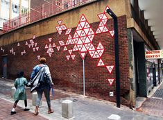 r1 arranges 100 yield signs in a johannesburg alleyway