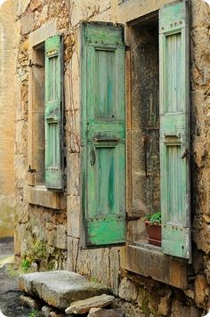 Incredible aged turquoise, blue green color on shutters.