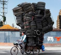"""These astounding images were captured by French photographer Alain Delorme . They are his latest series of photographs entitled """"Totems"""" tha. In This World, People Around The World, Around The Worlds, Cargo Bike, French Photographers, Weird Pictures, Beautiful Pictures, Totems, Belle Photo"""
