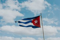Cuban flag against the sky by Natasa Kukic for Stocksy United