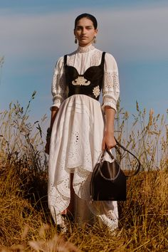 Trend Alert Maxi Dresses Spring 2019 The Fashion Folks Alexander McQueen Resort 2019 White lace dress black corset field earrings high collar Source by johannaehg fashion Haute Couture Style, Couture Mode, Couture Fashion, Runway Fashion, Cruise Fashion, Look Fashion, Trendy Fashion, Autumn Fashion, Fashion Outfits