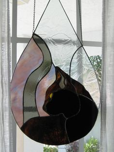 Hey, I found this really awesome Etsy listing at http://www.etsy.com/listing/101927950/black-cat-in-a-raindrop