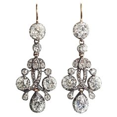 Important Antique Dutch Diamond Earrings, Netherlands, Circa 1850. Designed to suggest flowers and foliage joined together by ribbons.  Mounted in silver-topped gold,  diamonds, 7 - 7.5 carats total.