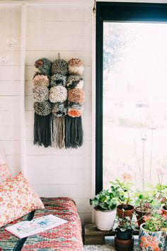 How to make a pom pom wall hanging. Tutorial by Lisa Tile for We Are Scout. Photo by Jeska Hearne of Lobster and Swan Yarn Crafts, Diy Crafts, Twine Crafts, Yarn Wall Hanging, Wall Hangings, Boho Home, Ideas Hogar, Textiles, Rustic Gardens