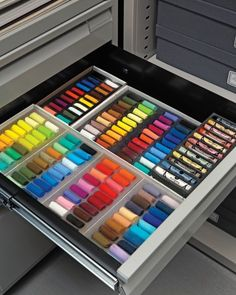 Supplies Darcy uses less frequently -- glitter and pastels, for instance -- are compartmentalized in drawers.