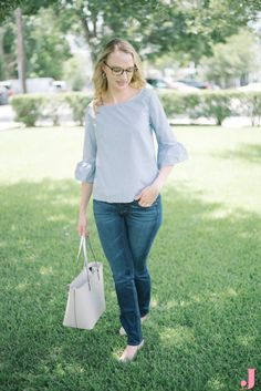 This bell sleeve Madewell top paired with dark denim is perfect for a casual Friday office look.