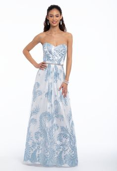 Be a belle en bleu wearing this beauteous ball gown prom dress! From the sweetheart neckline and corset back to the beaded belt that breaks up the bodice and skirt, this glittery gown is all the fairytale feels. Accessorize with low satin sandals and a satin evening clutch. #CamilleLaVie
