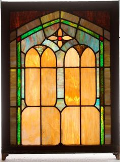 A STAINED GLASS AND LEADED WINDOW PANEL, CIRCA 1915. : Lot 826