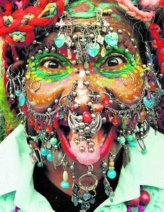 Elaine Davidson, has 6005 body piercings (1005 are internal) WOW can you handle!!