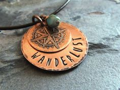 If you suffer from wanderlust, youll love this layered copper necklace. A small disc etched with a compass design is layered on top of a larger