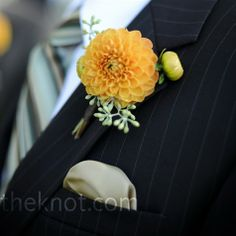 PERFECT. add turquoise ribbon, make the dahlia coral or pink, and we are in business.