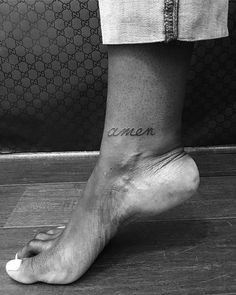 """Amen"" tattoo on the right inner ankle bone."