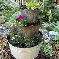 I had some old rusty buckets and an ugly stump to disguise. So I came… :: Hometalk