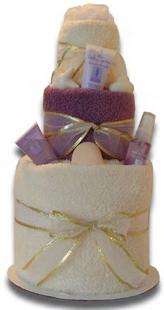 It's not just diaper cakes....noooo. This is a towel cake for a bridal shower (mother's day , birthday etc) Add some lotions, sprays, bubble baths, body washes, you get the point! Cute!