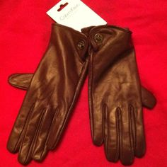 Calvin Klein Leather Tech Gloves Authentic Calvin Klein Leather Tech Gloves for Women. Color: Fig in this case is a mixture of Dark Purple and Brown, comparable to Plum. 2 Text Enabled Fingers on each glove. Black Trim on those Tips. Gun Metal Calvin Klein Logo Lock Closures at each wrist. Lining is 100% Polyester. Brand New! Excellent Condition. No Trades. Bright Scarf is listed separately in a Bundle. Calvin Klein Accessories Gloves & Mittens